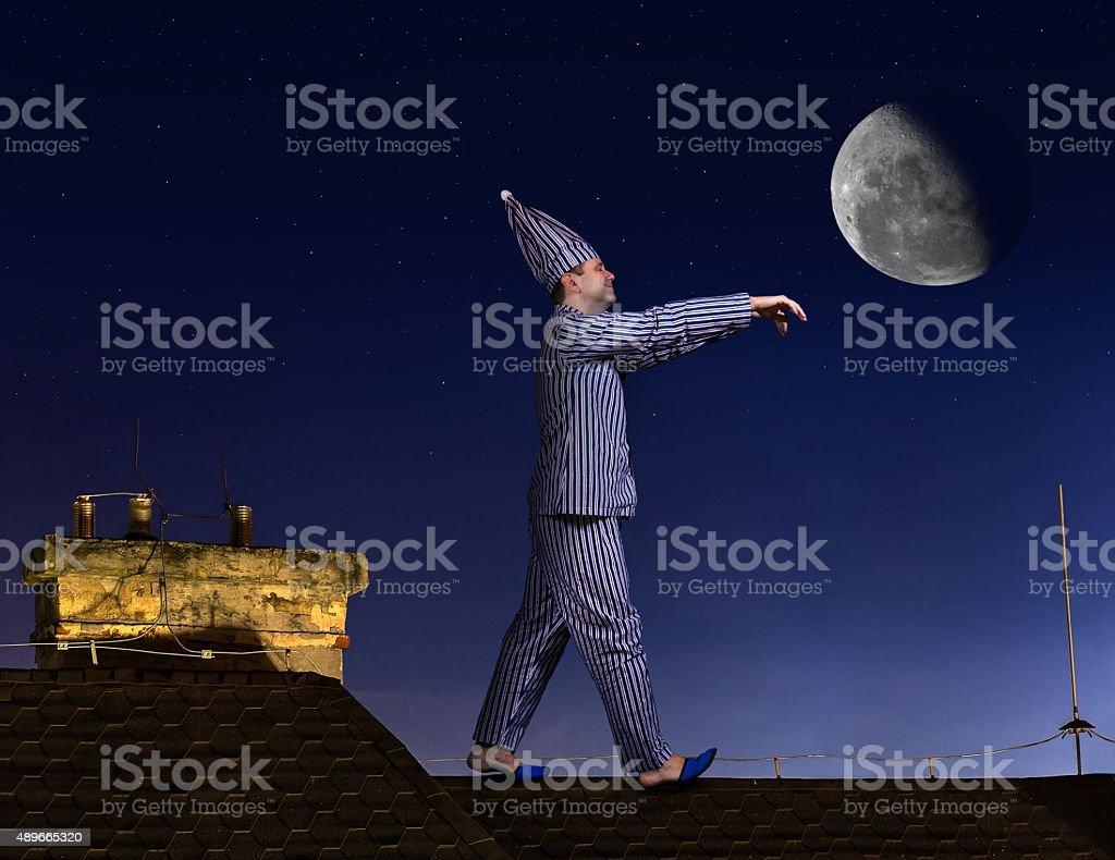 Sleepwalker walking on roof stock photo