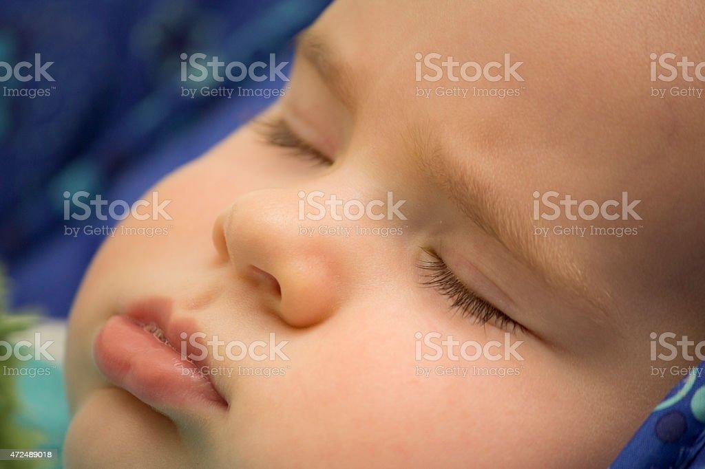 Sleepy baby boy stock photo