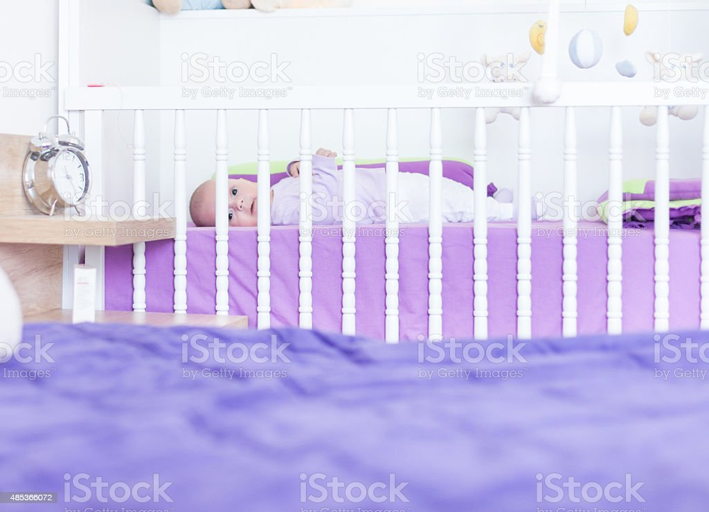 Sleepy baby waking up stock photo