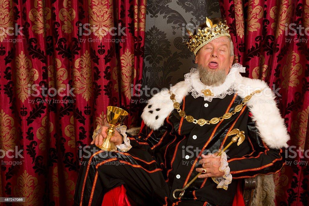 Sleepy drunk king stock photo