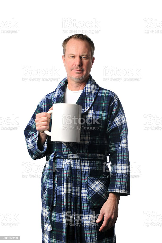 Sleepy Man in his Robe with Giant Cup of Coffee stock photo