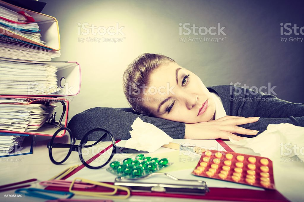 Sleepy tired businesswoman at work. stock photo