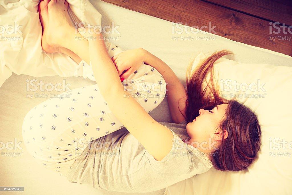 Sleepy woman sleeping in the bed. stock photo
