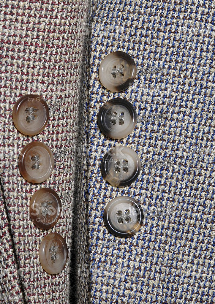Sleeves and buttons detail of coats royalty-free stock photo