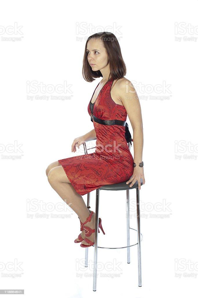 slender girl in red dress listening to somebody stock photo