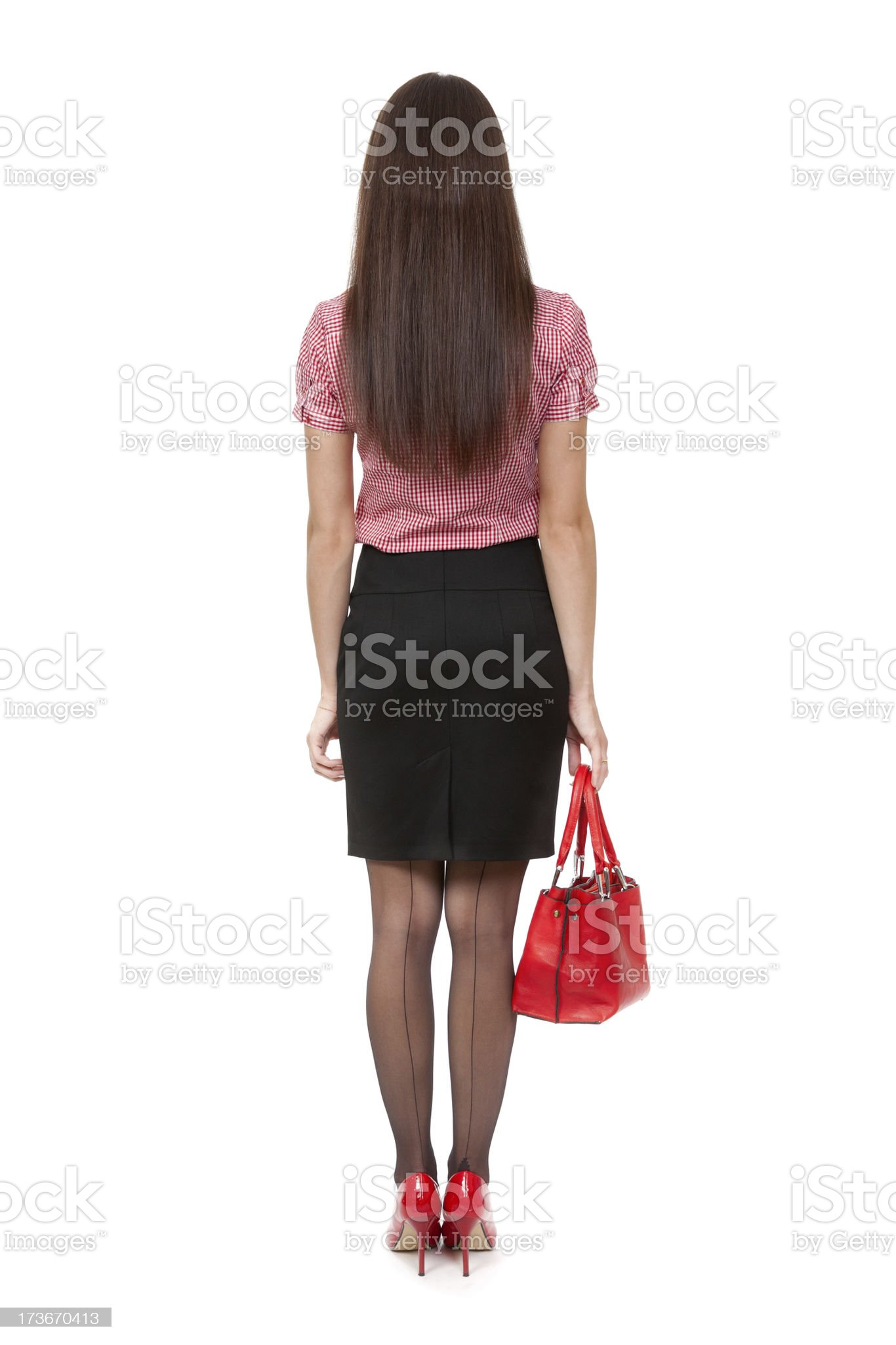 slender girl with a bag in the studio royalty-free stock photo