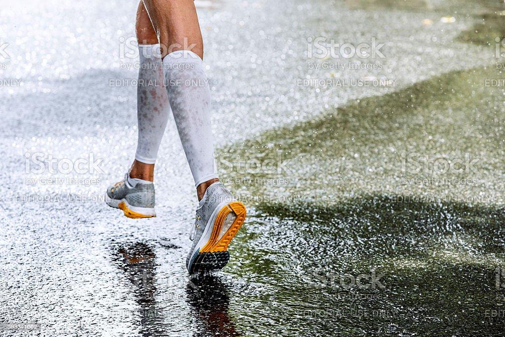 slender legs of women marathoner in compression socks stock photo