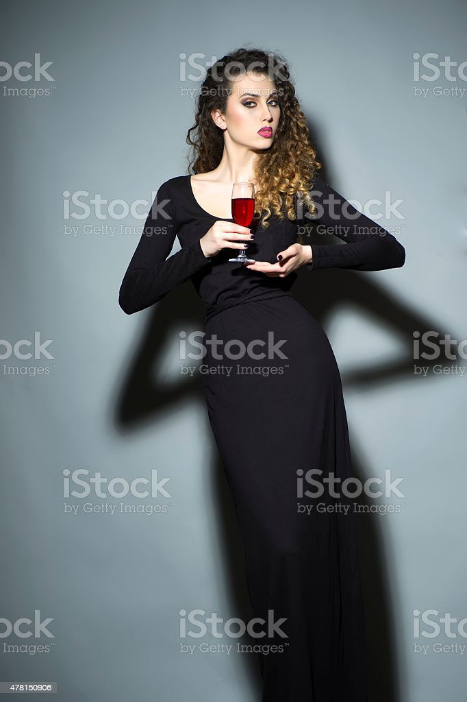 Slender pretty woman with wineglass stock photo