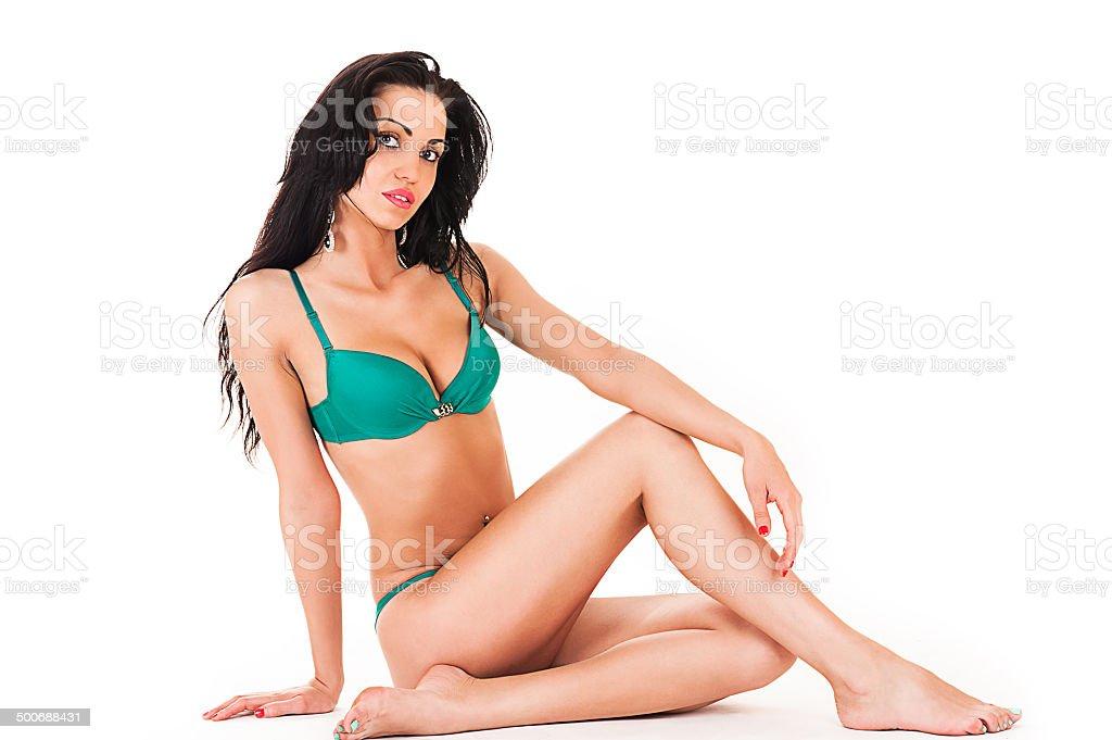 slender woman in green underwear stock photo