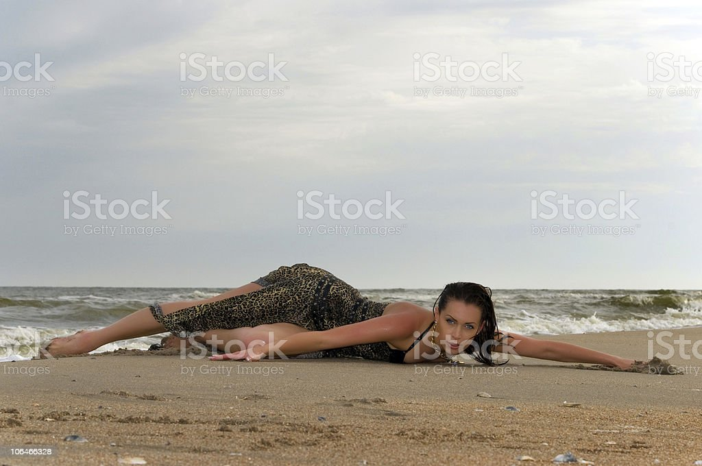 slender woman lying on the beach stock photo