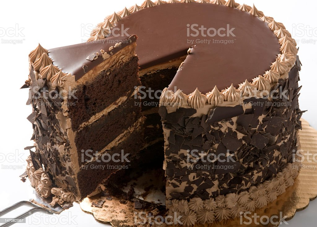 A slice being removed from a chocolate cake stock photo