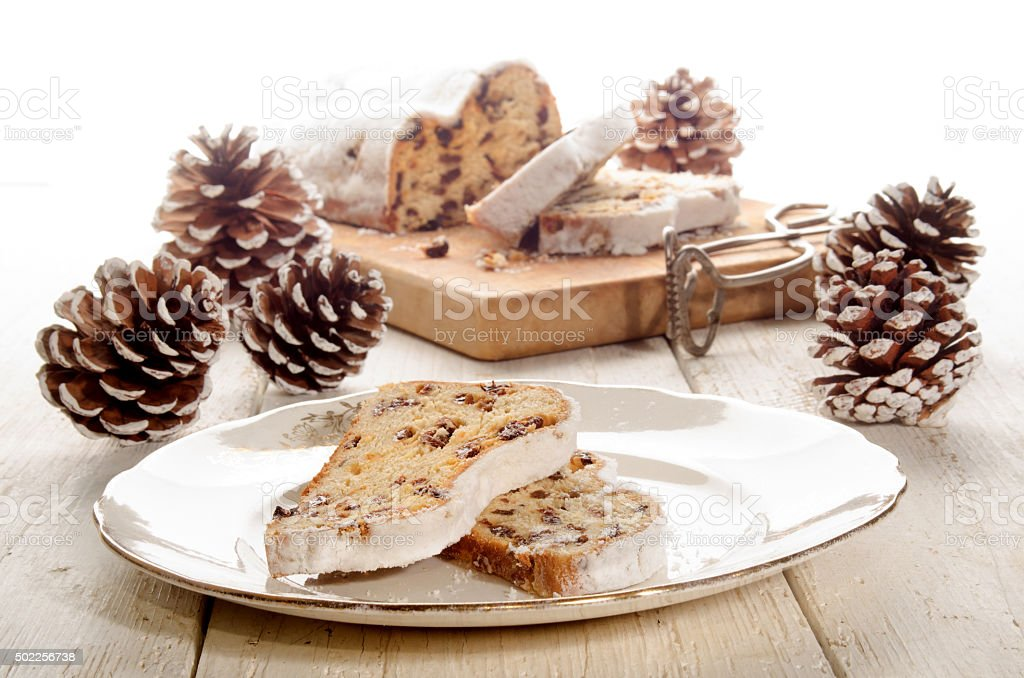 slice christmas stollen on a plate stock photo