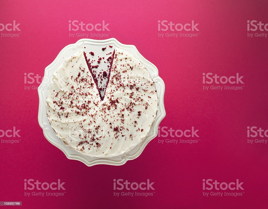Slice missing from chocolate cake on cakestand stock photo