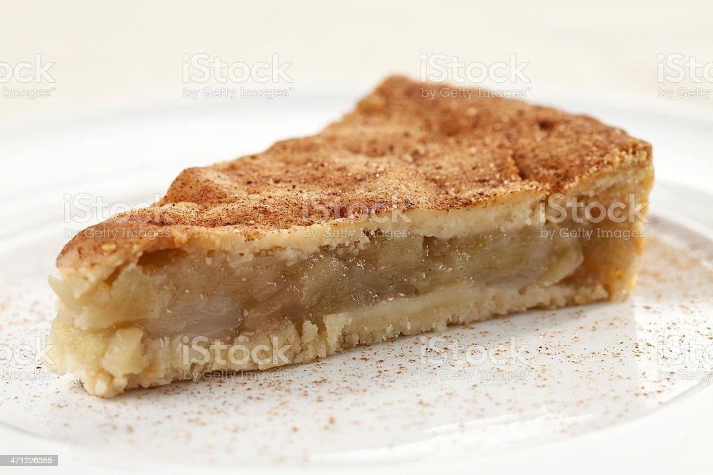 A slice of apple pie with cinnamon stock photo