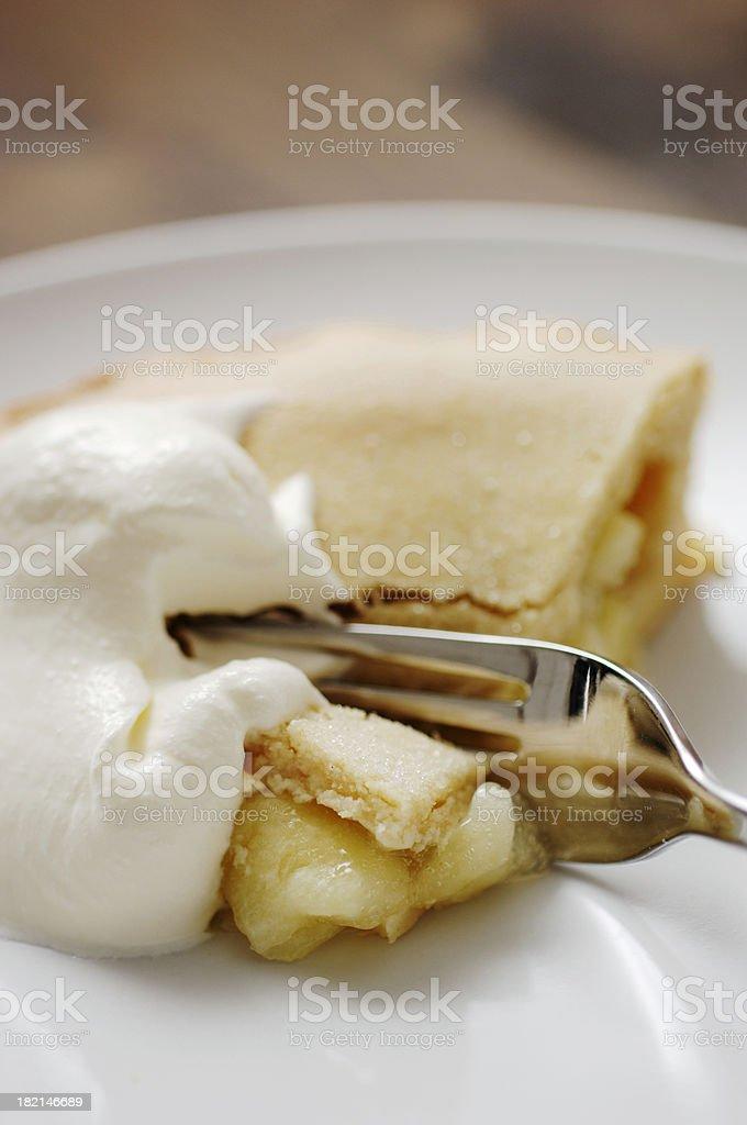 slice of apple pie with thick cream stock photo
