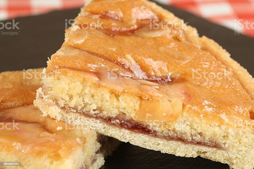 slice of bakewell tart stock photo