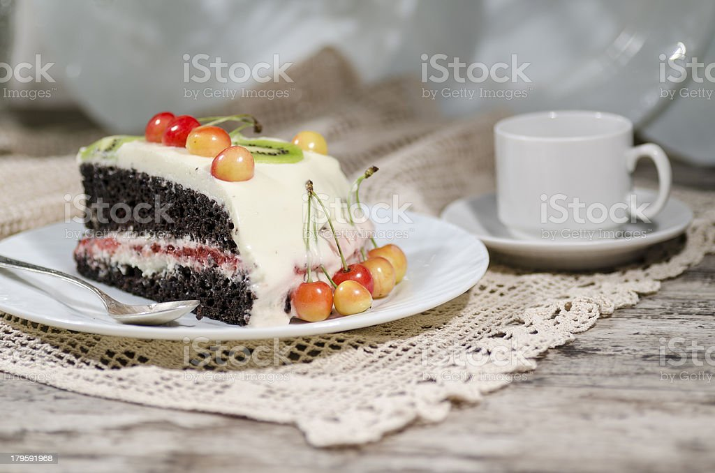 Slice of bird-cherry flour cake with cherries and cup coffee royalty-free stock photo