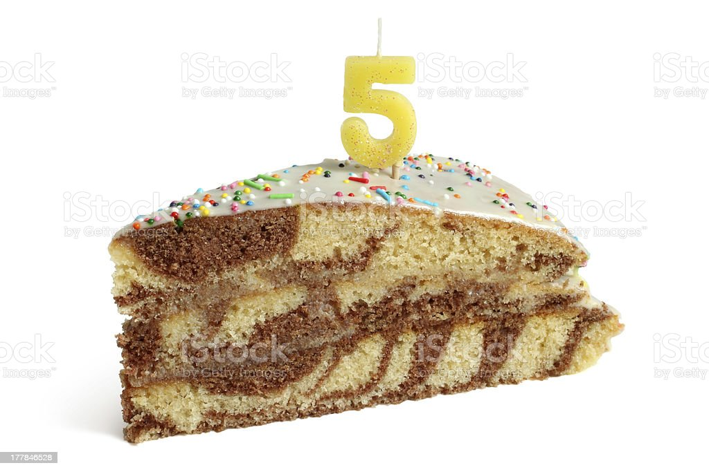 Slice of birthday cake with number five candle royalty-free stock photo