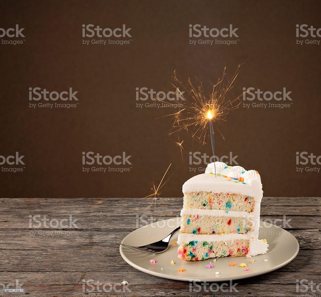 Slice of Birthday Cake with Sparkler stock photo