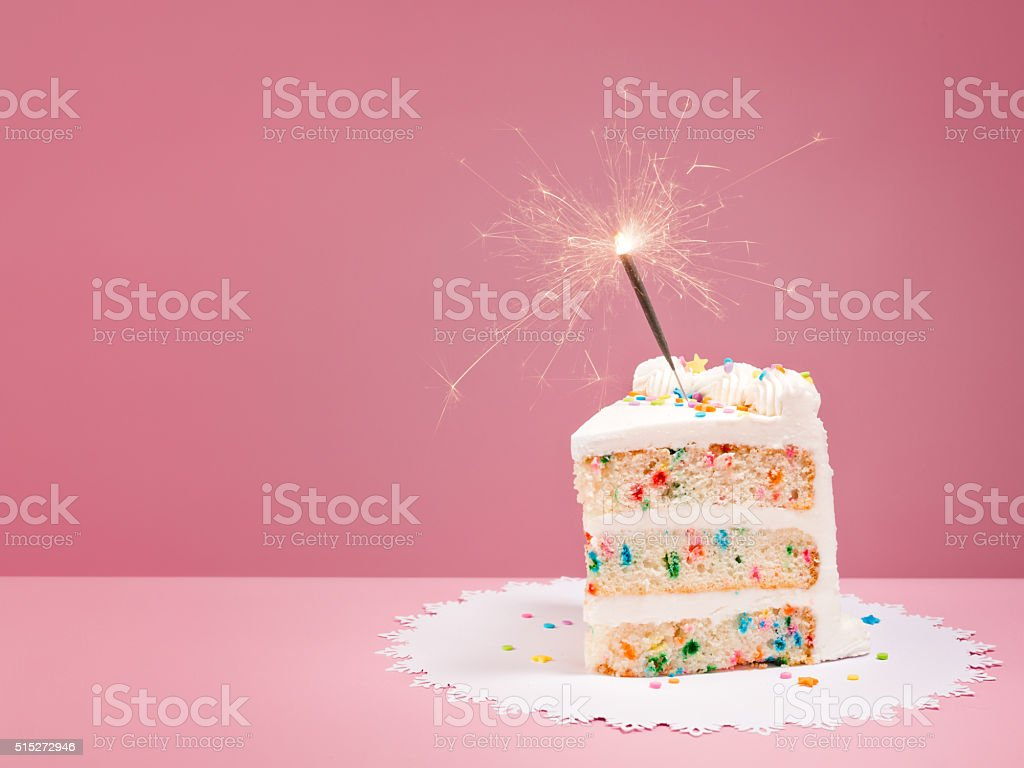 Slice of Birthday Cake with Sparkler stock photo