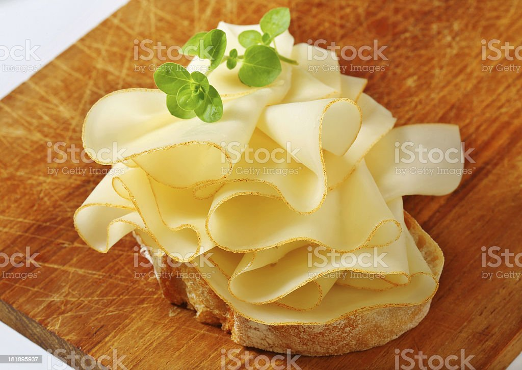 Slice of bread with folded cheese royalty-free stock photo