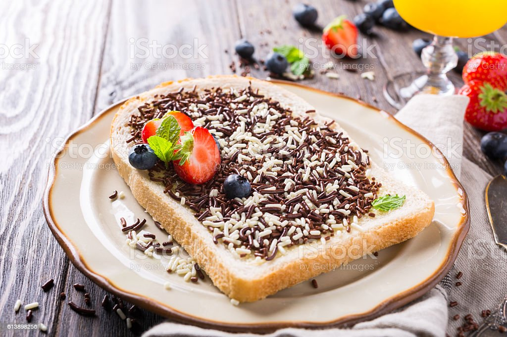 Slice of bread with hagelslag chocolate sprinkles stock photo