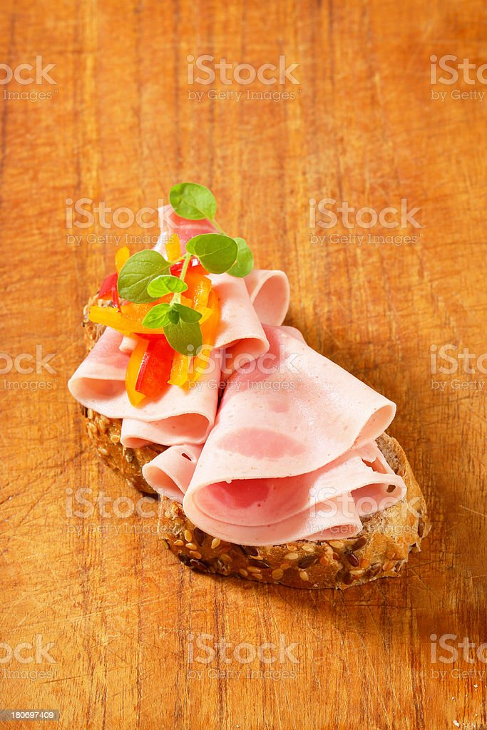 slice of bread with ham and peppers royalty-free stock photo