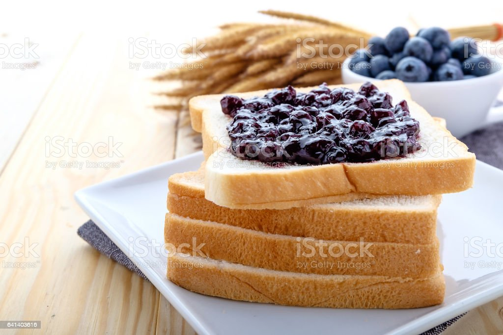 slice of bread with jam blueberry stock photo
