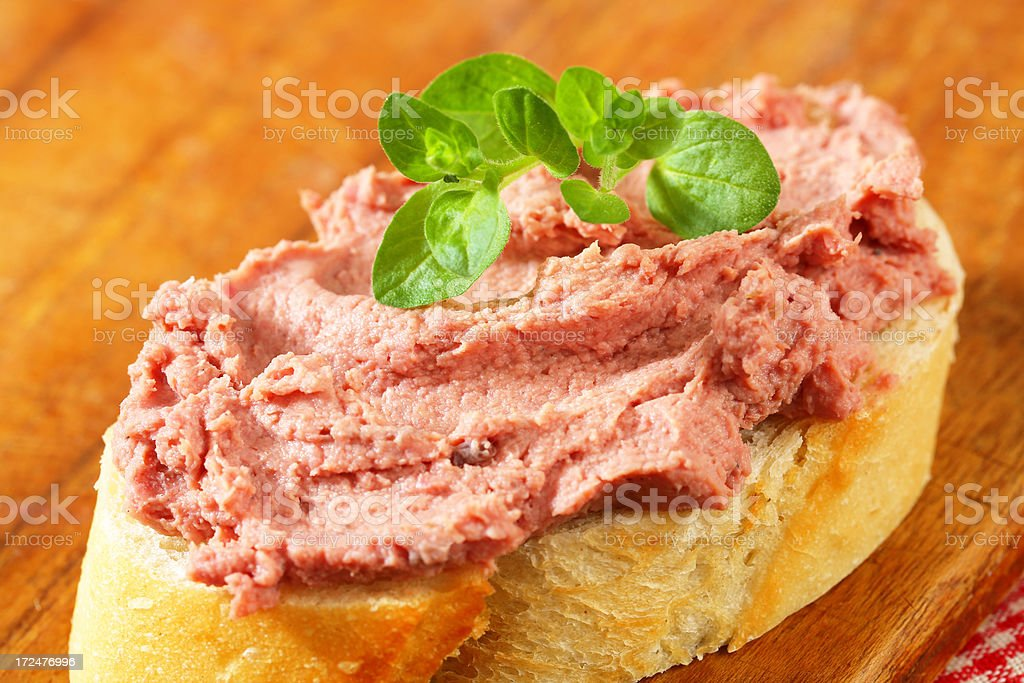 Slice of bread with liver pate royalty-free stock photo