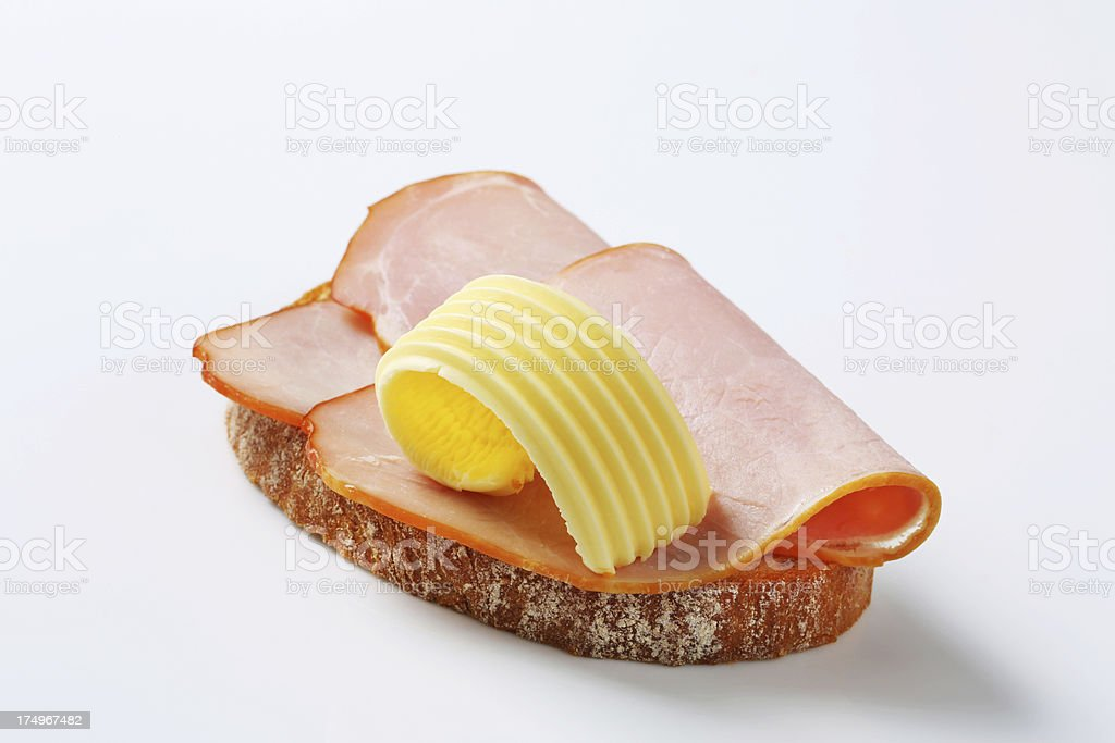 Slice of bread with smoked ham stock photo