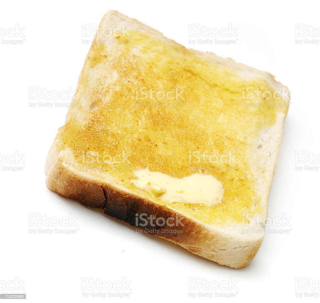 slice of buttered white toast royalty-free stock photo