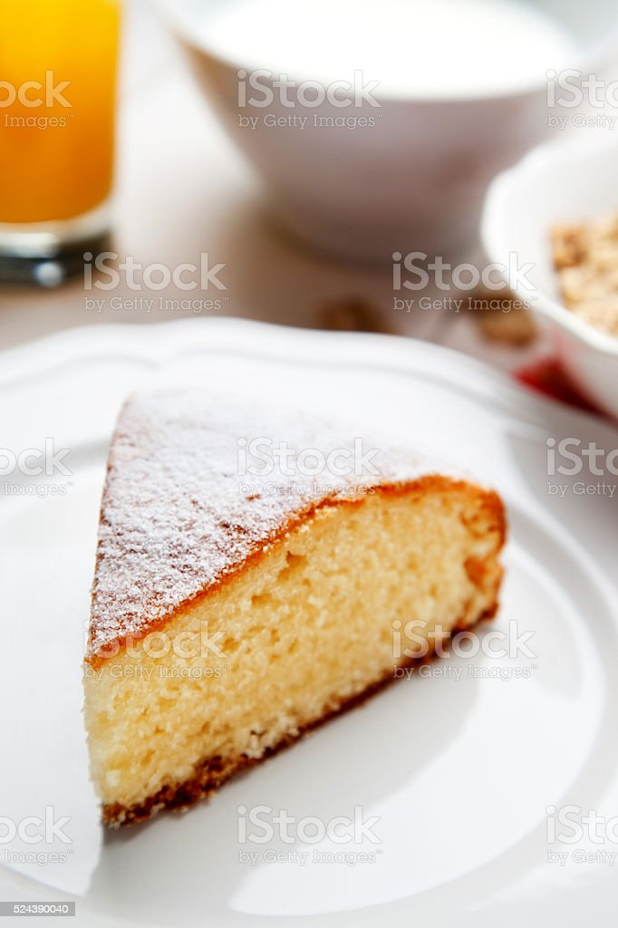 slice of cake with orange juice milk and cereal stock photo