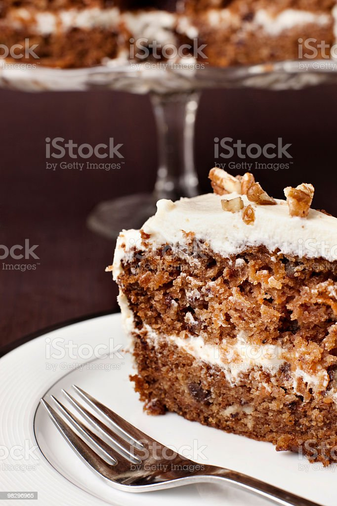 Slice of carrot cake close-up stock photo