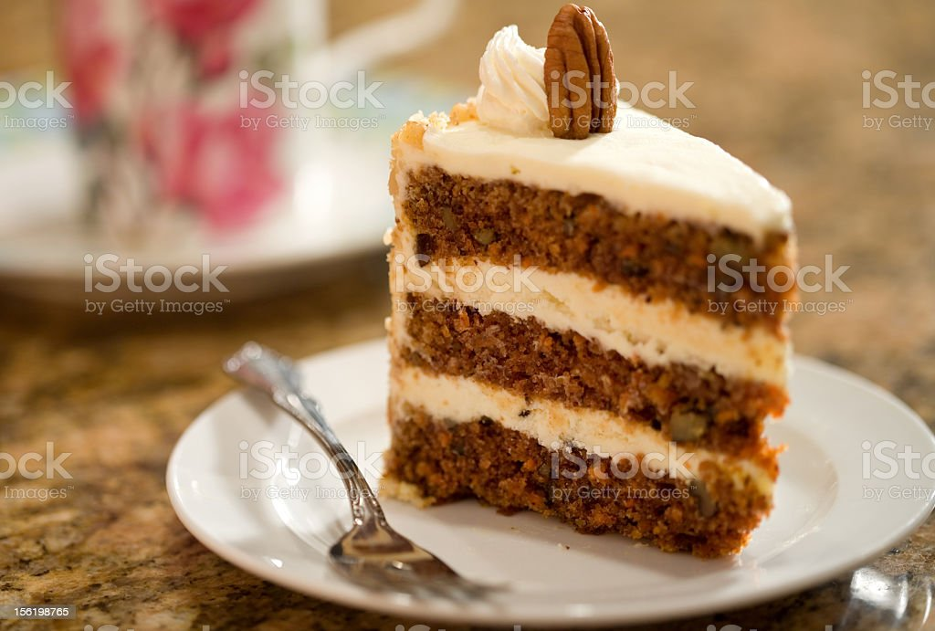 A slice of carrot cake made of three layers on a plate stock photo