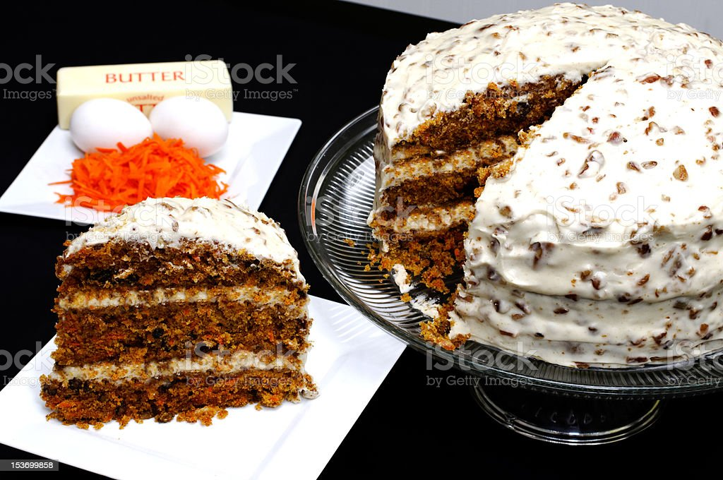 Slice of Carrot Cake with Ingredients stock photo