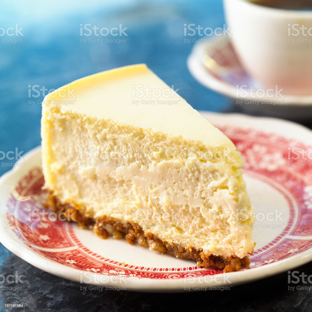 Slice of cheesecake on a red and white plate stock photo