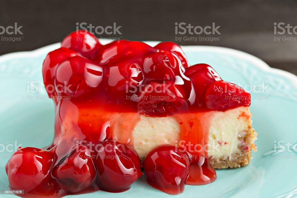 Slice Of Cherry Topped Cheesecake stock photo