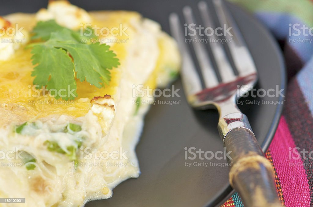Slice of Chicken Tortilla Pie Casserole on Black Plate stock photo