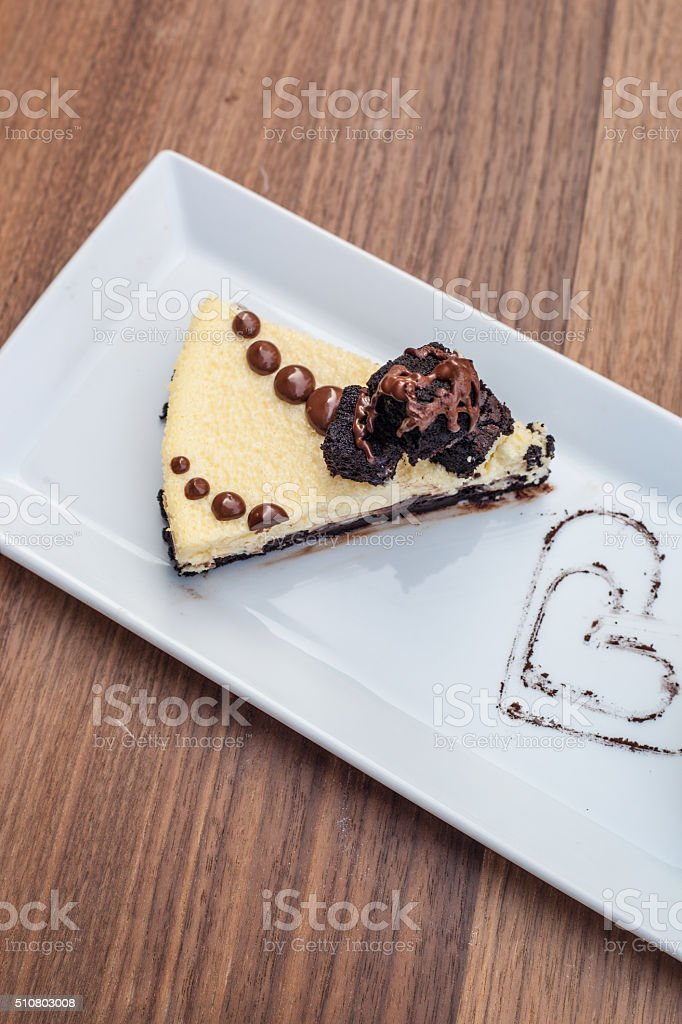 Slice of Chocolate Brownie Cheesecake with Bonbons stock photo