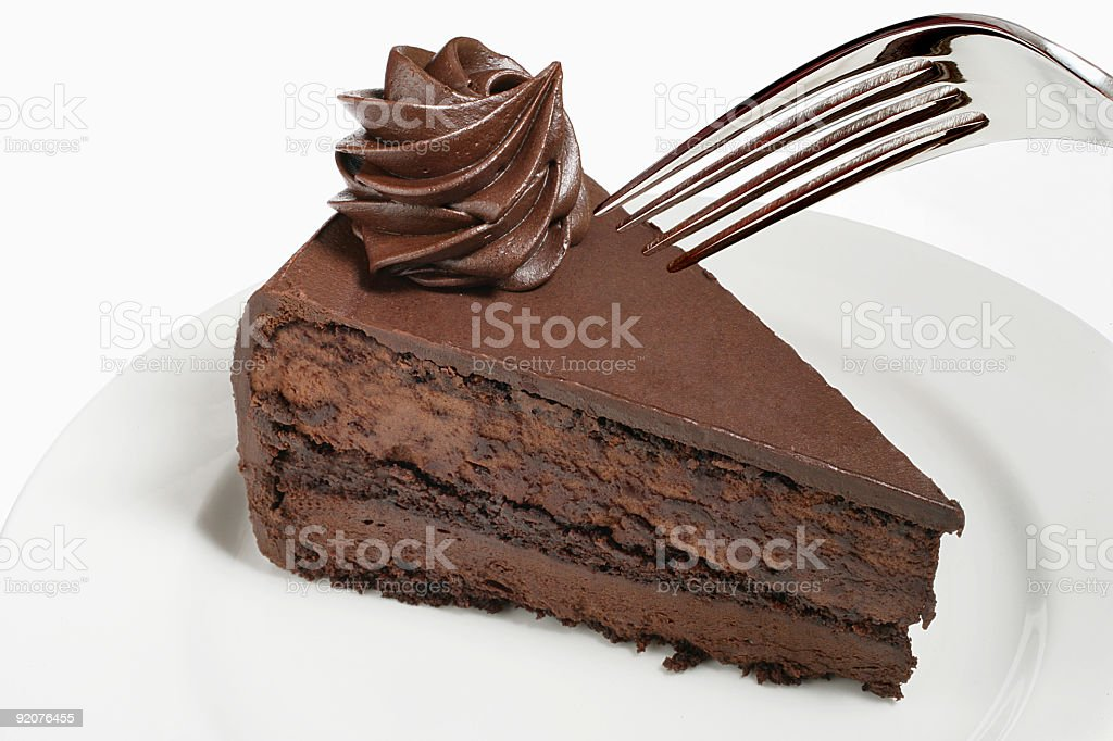 Slice of chocolate cake and fork royalty-free stock photo