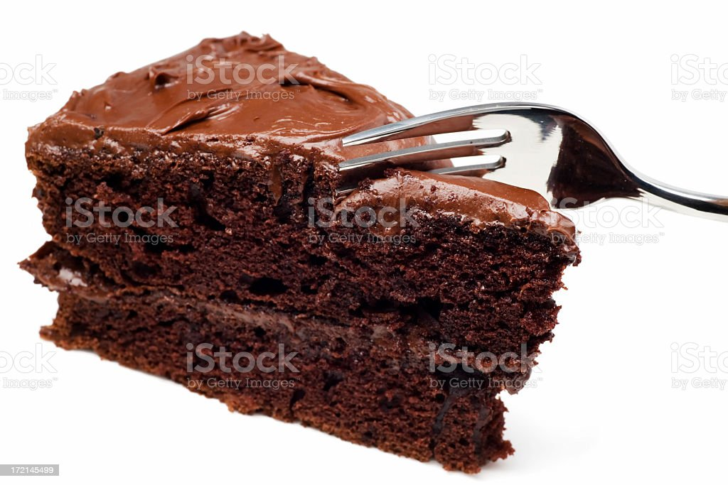 A slice of chocolate cake with a fork royalty-free stock photo