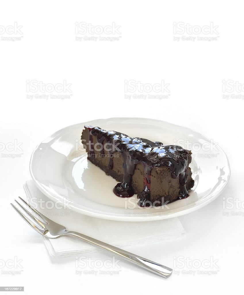 Slice of chocolate cheesecake on white plate royalty-free stock photo