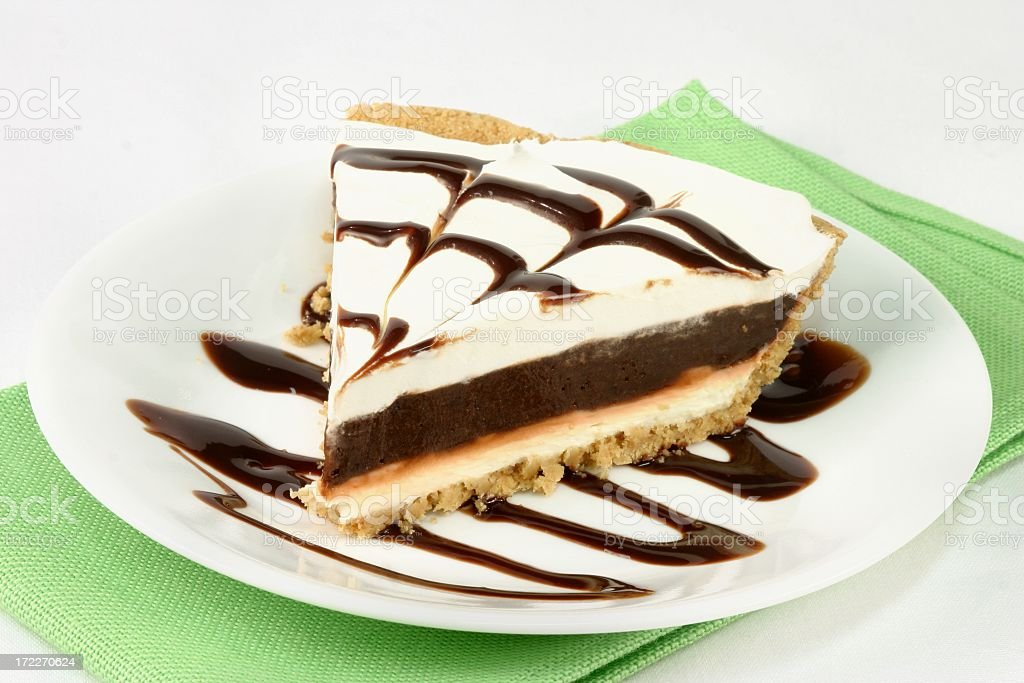 Slice of Chocolate Cream Pie on plate with napkin stock photo