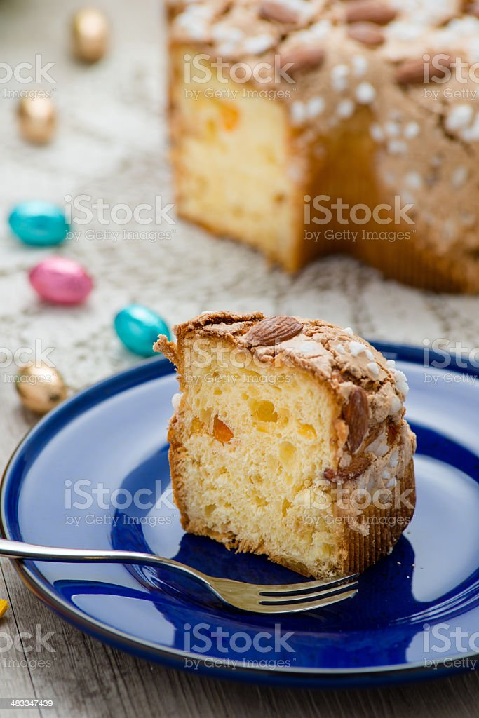 Slice of Easter dove with Easter sweets stock photo