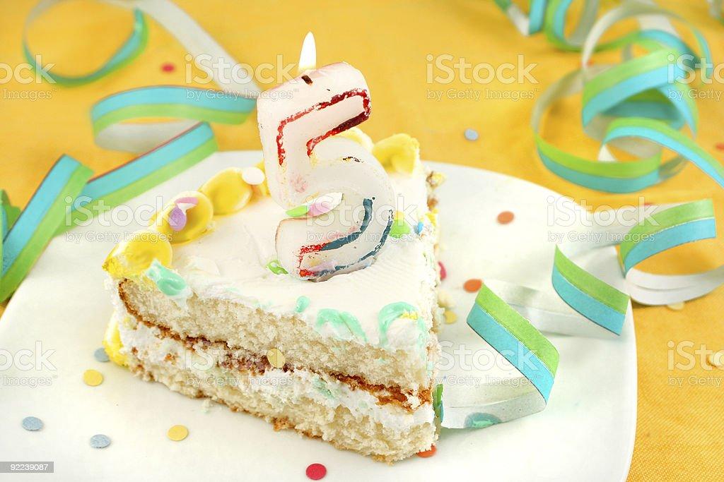 slice of fifth birthday cake stock photo