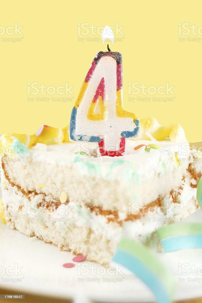 slice of fourth birthday cake stock photo