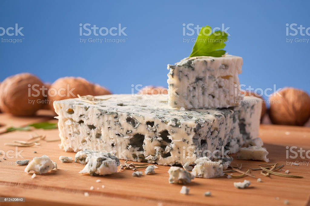 Slice of French Roquefort cheese stock photo
