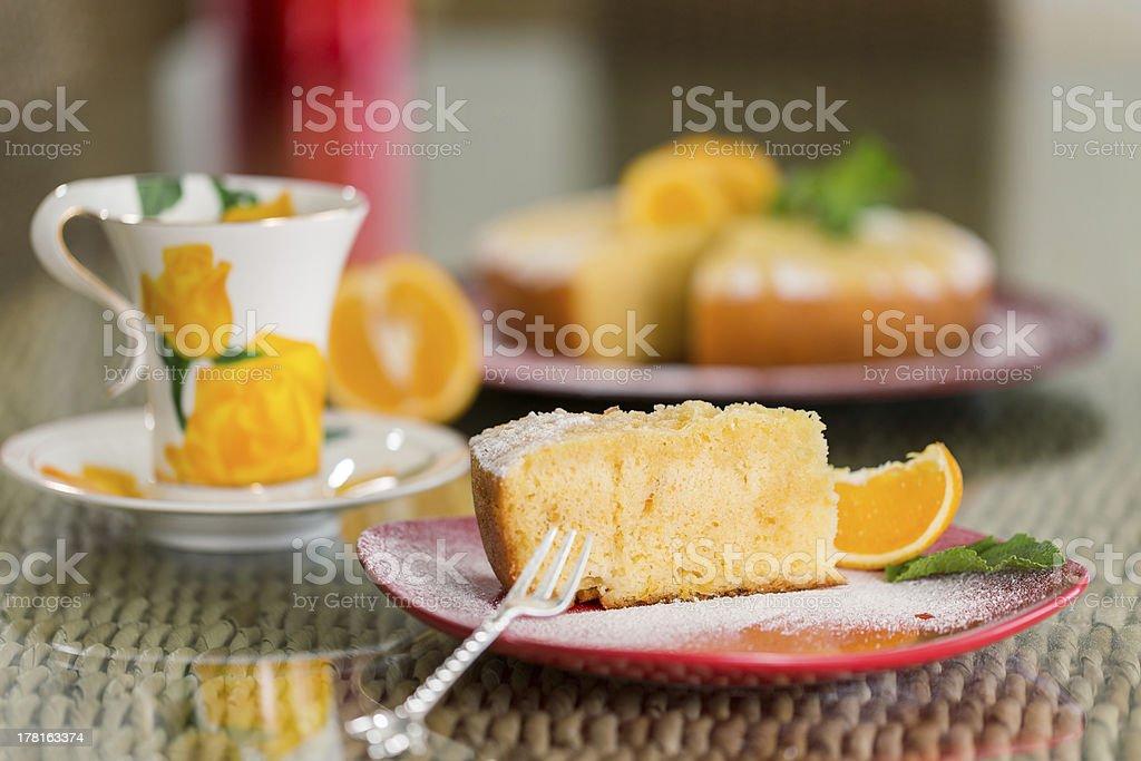 Slice of freshly cooked orange cake royalty-free stock photo