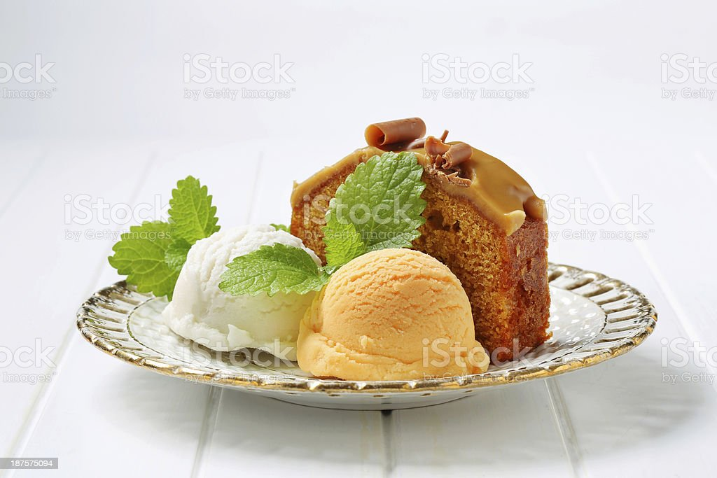 Slice of gingerbread cake with ice cream royalty-free stock photo