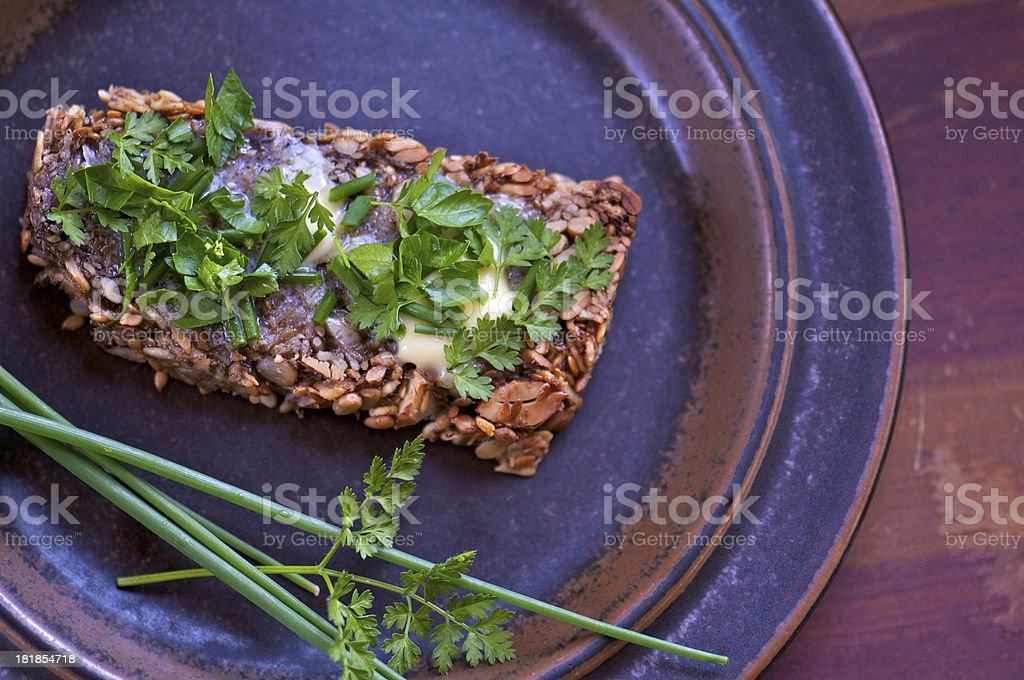 Slice of Gluten-Free Bread with Butter and Herbs from Above royalty-free stock photo